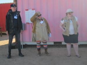 Director Von Busch, Frau Fiber, and Director Clugage lead the morning briefing