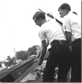 Rum barrel being buried at sea, August 1, 1970